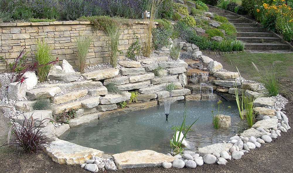 Pond design warwickshire swimming ponds staffordshire for Garden pond stones