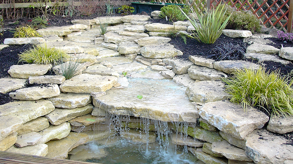Pond design warwickshire swimming ponds staffordshire for Rock ponds designs